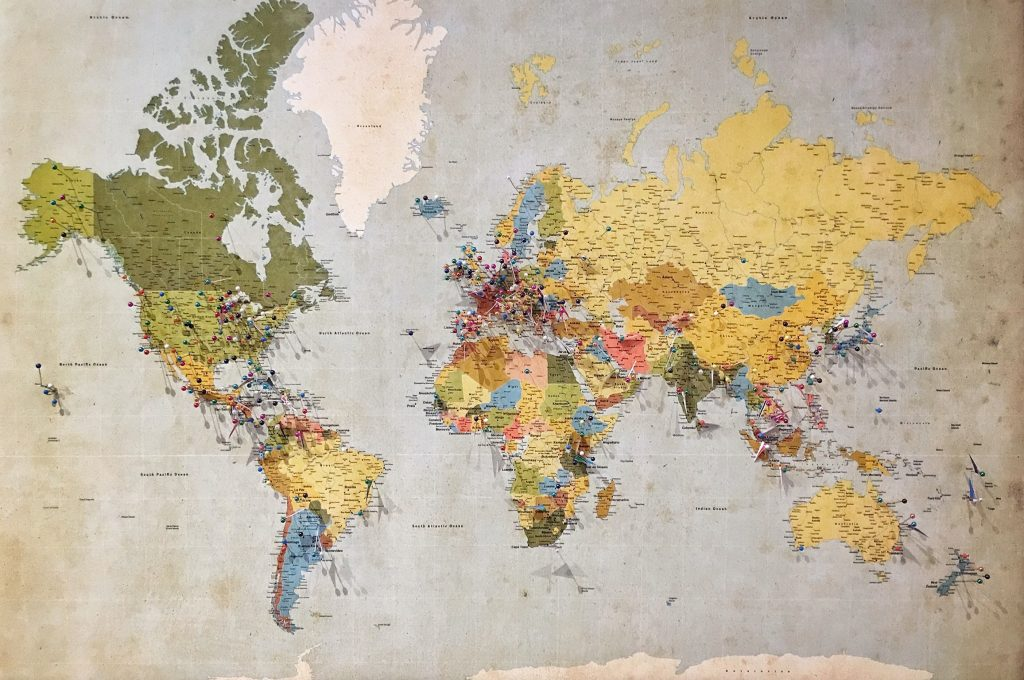A map of the world with pins placed in various locations